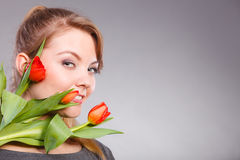 Girl with tulip feel connection to nature. Stock Photos