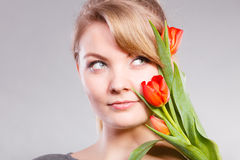 Girl with tulip feel connection to nature. Royalty Free Stock Photos