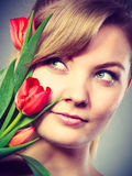 Girl with tulip feel connection to nature. Royalty Free Stock Photo