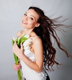 Girl with tulip flowers Stock Image