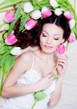 Girl with tulip flowers Stock Photography