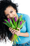 Girl with tulips Stock Image