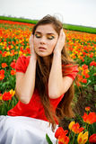 Girl in tulips field Stock Photo