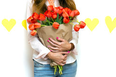 Girl and tulips Stock Photography