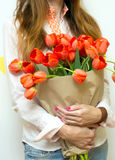 Girl and tulips Royalty Free Stock Photography