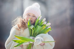 Girl with tulips in spring park. Beautiful girl with tulips in spring park Royalty Free Stock Photo