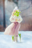 Girl with tulips in spring park Stock Photo