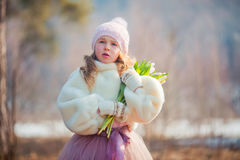 Girl with tulips in spring park Stock Images
