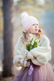 Girl with tulips in spring park. Beautiful girl with tulips in spring park Royalty Free Stock Photography