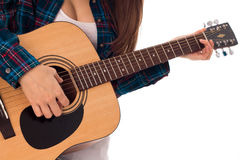 Girl tunes the guitar. Close up of girl tunes the guitar isolated on white background Stock Photos
