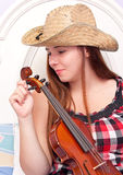 Girl Tuning Her Violin Royalty Free Stock Images