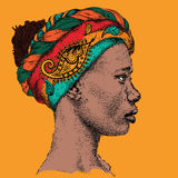 Girl in turban with African hand draw ethno pattern, tribal background. Beautiful black woman. Profile view. Vector illustration. Girl in turban with African Stock Photo
