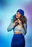 Girl in a turban. Young beautiful girl in a turban blouse and skirt, as airlines stewardess Royalty Free Stock Photo