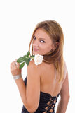 Girl with turn back holding a rose Royalty Free Stock Photos
