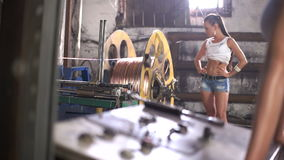 Girl turn on machine factory stock footage