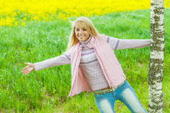 Girl is turned round birch Royalty Free Stock Photo