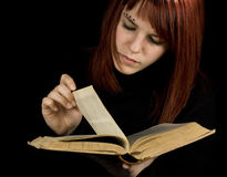 Girl turning book pages Royalty Free Stock Photo