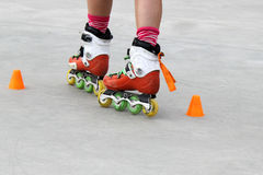 Girl turning while skating. With cones Royalty Free Stock Photos