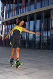 Girl turning skating in-line. In the city Stock Images