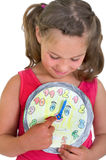 Girl turns on the clock Royalty Free Stock Photography