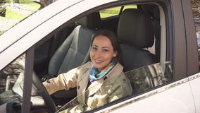 Girl turns his head and smiles in the car stock footage