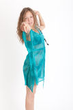 Girl in a turquoise dress Stock Photography