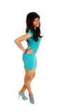 Girl in turquoise dress. Stock Images