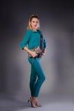 Girl in turquoise posing in studio Royalty Free Stock Photos