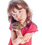 The girl with a turtle Stock Photos