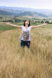 Girl in tuscany wheat field Royalty Free Stock Photos
