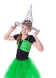 Girl in tutu skirt and halloween hat Stock Photos