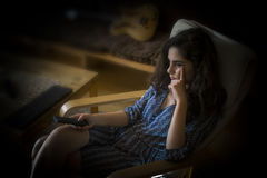 Girl with TV Remote Royalty Free Stock Photos