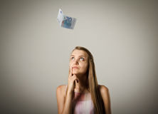 Girl and twenty euro. Currency and lottery concept. Young woman is doing something Royalty Free Stock Photos