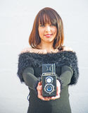Girl with twin lens reflex camera. Stock Image