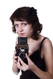 Girl with a twin-lens reflex camera Stock Image