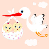 Girl twins. Cheerful stork transfers in flight newborn baby girls Royalty Free Stock Images