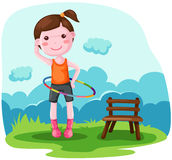 Girl twirling hula hoop Royalty Free Stock Image