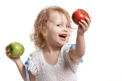 Girl with two apples. Happy girl holding two apples in her hands Stock Image