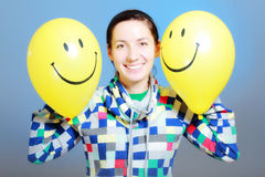 Girl with two balloons Stock Photos