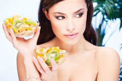 Girl with two bowl full of fruit Royalty Free Stock Images