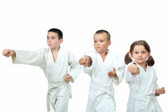 The girl and two boys in kimono beat punch arm stock photos