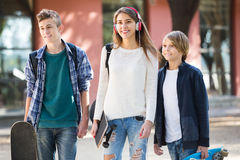 Girl and two boys with skateboards Stock Images