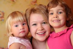 Girl with two children Stock Photos