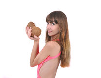 Girl with two coconuts in hand Stock Photo