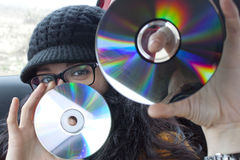 Girl with two compact discs Royalty Free Stock Photography