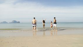 Girl And Two Couple Running In Water Holding Hands, People On Beach Tourists. Slow Motion 120 stock video footage
