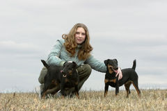 The girl with two dogs royalty free stock image