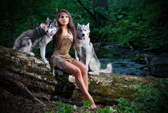 Girl with two dogs at forest Royalty Free Stock Photography