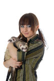 Girl with two domestic polecats Stock Photo