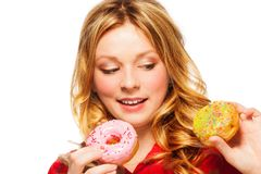 Girl with two donuts Royalty Free Stock Images